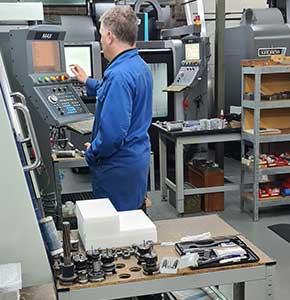 Engineer working on machine